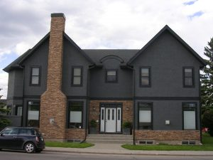 New home in Calgary Stucco installed and painted by the team at Legacy Exteriors