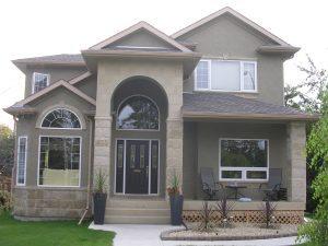 New Shingles and Stucco on a Calgary Home