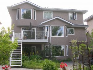 New window cladding and exterior stucco siding