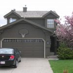 Dark Brown Stucco Painting in Calgary