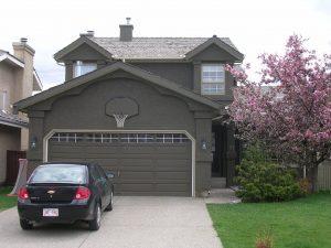 Calgary Home Stucco Repainted Dark brown